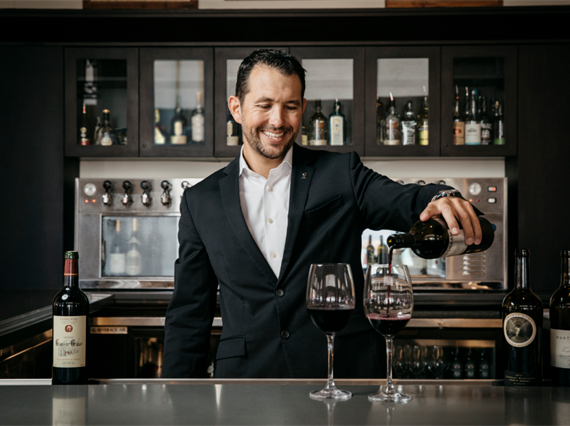 General manager pouring wine