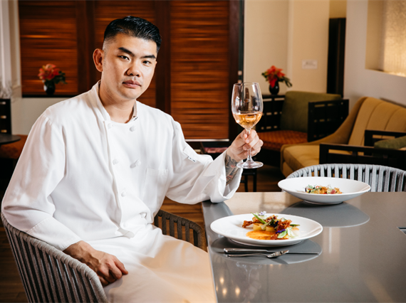 Chef with wine and food
